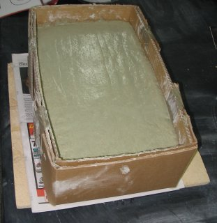 Cement patted into box